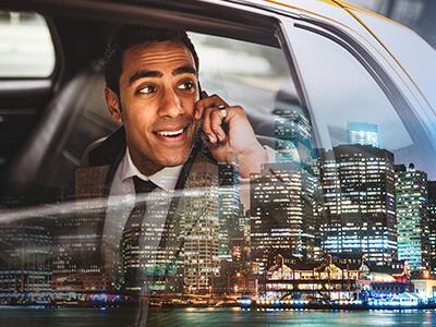 Businessman in a New York taxi on the phone