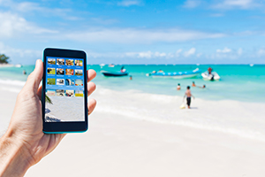 Someone using a mobile phone on the beach
