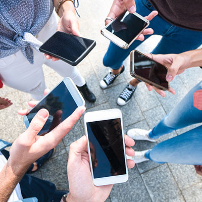 Group of friends on their mobile phones